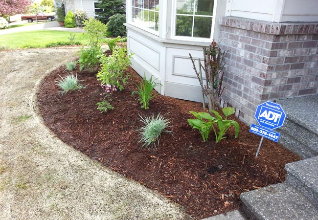 Mulching services by Green Thumb Company